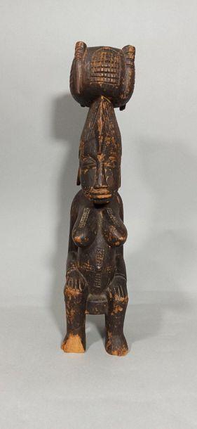 Statuette féminine assise Senoufo, Côte d'Ivoire....