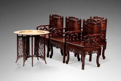 INDOCHINE, Vers 1900  Quatre fauteuils en...