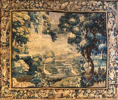 AUBUSSON  Tapisserie « verdure » à décor de deux volatiles devant une cascade....