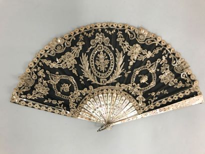 Lace flowers, circa 1900-1920 Two fans *One, the leaf in bobbin lace, with the central...