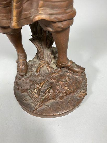 ANFRIE Charles, 1833-1905  Jeune femme au chapeau saluant  bronze à patine brun...