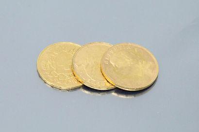 Lot composé de trois pièces en or de 20 Francs...
