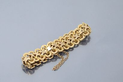 Bracelet en or jaune 18k (750) à maille gravée....