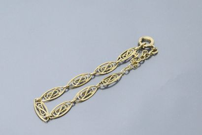 Bracelet en or jaune 18k (750) à maille ajourée....