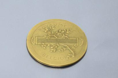 Médaille en bronze dorée  Avers : la Renommée tenant dans sa main droite une branche...
