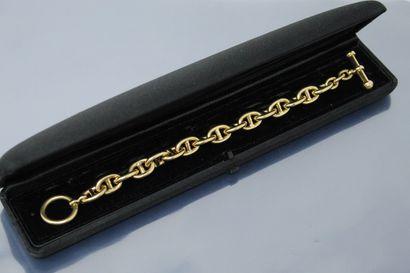 Bracelet en or jaune 18k (750) à maille chaine...