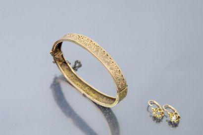 Lot d'or jaune 18k (750) composé d'un bracelet...