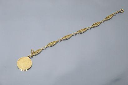 Bracelet en or jaune 18k (750) à maille navette...