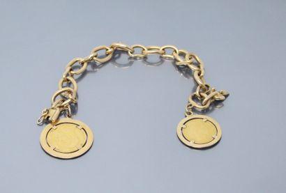 Bracelet en or jaune 18k (750) orné de deux...