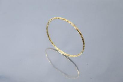 Bracelet jonc tressé en or jaune 18k (750)....