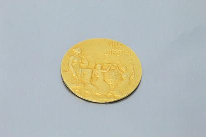 Médaille circulaire en or jaune 18k (750)...