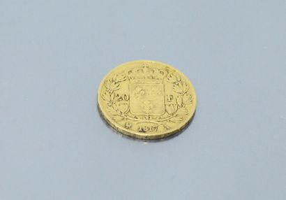 Pièce en or de 20 francs Louis XVIII Buste nu 1817 A (Paris).    Poids : 6.45 g...