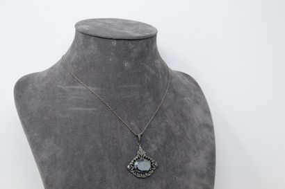 Two chains and their silver pendants decorated with amethysts and imitation stones....