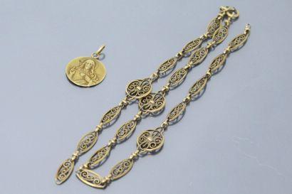 Pendentif médaille en or jaune 18k (750)....