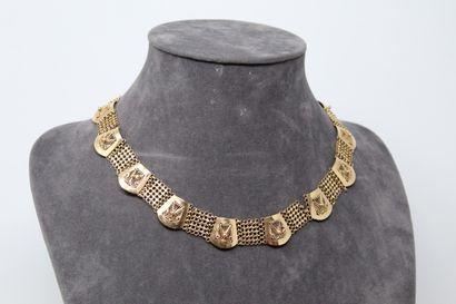 Important collier en or jaune 14k (585) à...