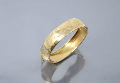 Bracelet jonc en or jaune 18k (750) à décro...