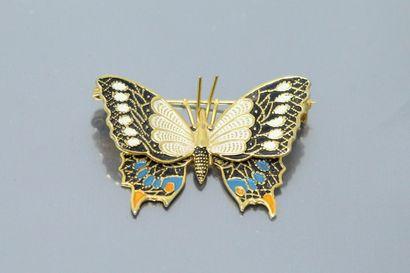 Broche en métal doré stylisant un papillon,...