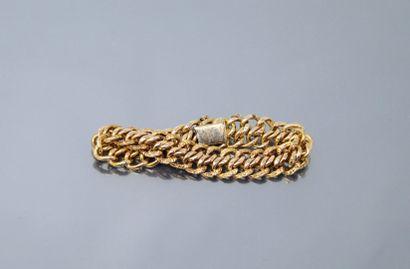 Bracelet en or jaune 18k (750) à mailles...