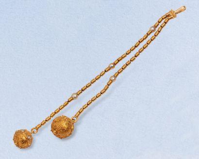 Pendentif asymétrique en or jaune 18K (750)...