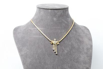 Collier-pendentif rétro articulé en or jaune...