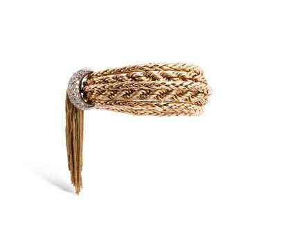 Pierre STERLE  Demi parure comprenant :  - un bracelet souple en or jaune 18K (750)...
