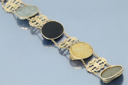 Articulated bracelet in 18K (750) yellow gold with alternating plant motifs and...