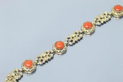 Bracelet articulé en argent (835) doré, ciselé...