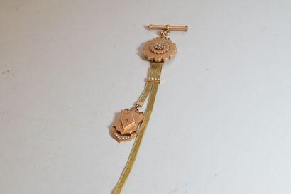 Chaine giletière en or jaune 18k (750) orné...