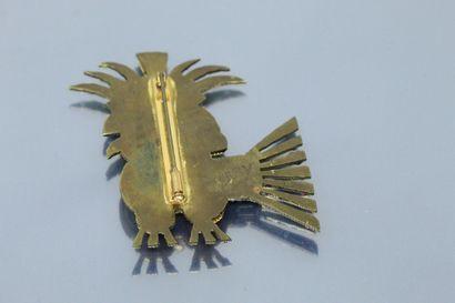Broche en métal signée TERRY représentant un oiseau avec un chapeau, orné de perles...