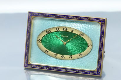 SHILD & Co  Rectangular gilt metal clock with a green and blue dial and Arabic numerals...