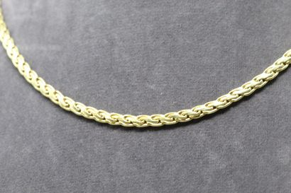 Necklace in yellow gold 18k (750) with flat mesh.  Necklace size : 45 cm - Weight...