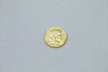 Pièce en or de 20 francs Coq 1909.  Poids...