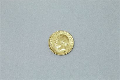 Gold coin of 1 George V sovereign (1912).  Weight : 7.92 g.
