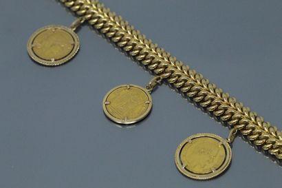 Bracelet en or jaune 18k (750) à double maille...