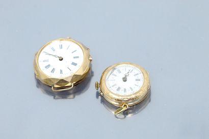 Débris : deux épaves de montres, boîtes en or jaune 18k (750).    Poids brut : 36.30...