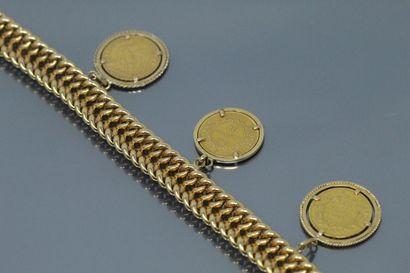 Bracelet en or jaune 18k (750) à double maille gourmette, trois pièces d'or françaises...