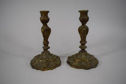 Paire de flambeaux en bronze de style Rocailles....