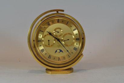 Pendulette de table LOOPING en métal doré...