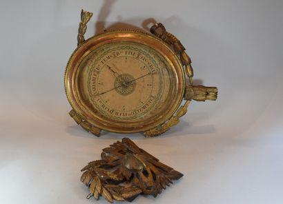Baromètre de style Louis XVI en bois doré...