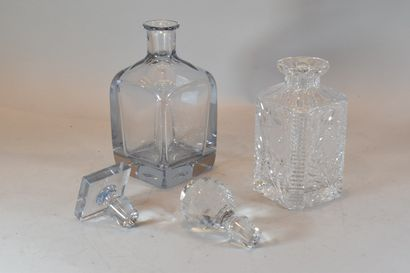 Set of two whisky decanters, one in cut crystal with flowers and hexagonal section,...