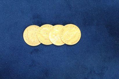 Lot de quatre pièces en or comprenant :...