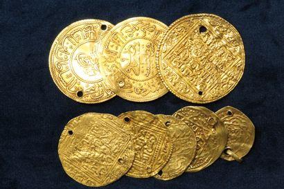Lot de 8 monnaies d'or, dont notamment des monnaies turques.  Poids brut de l'ensemble...