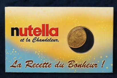 Pièce en or de 10 francs au coq, 1909, sous scellé.  Dans un étui de la marque Nutella...