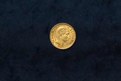 Une pièce en or de 20 francs Napoléon III...