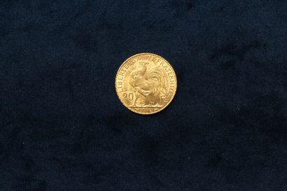 Une pièce en or de 20 francs au Coq (1912 A)  Poids : 6.45 g.  TB à TTB