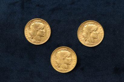 Trois pièces en or 20 francs Coq 1907.  TB...