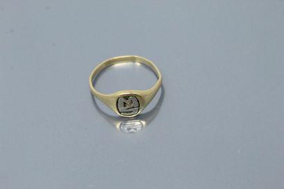 """Chevalière en or jaune 18K (750), monogrammée """"MS"""".  Tour de doigt : 54. - Poids..."""