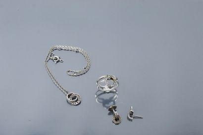 Parure en or gris 18K (750) et diamants composée...