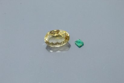 Lot including a rectangular emerald and an...