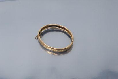 Bracelet rigide en or jaune 18k (750) gravé...